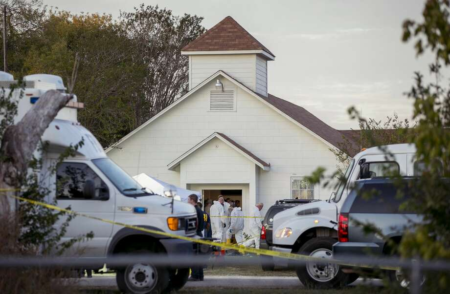 Investigators work at the scene of a mass shooting at the First Baptist Church in Sutherland Springs, Texas, on Sunday Nov. 5, 2017. A man opened fire inside of the church in the small South Texas community on Sunday, killing more than 20 people.(Jay Janner/Austin American-Statesman via AP)/Austin American-Statesman via AP) Photo: Jay Janner/AP