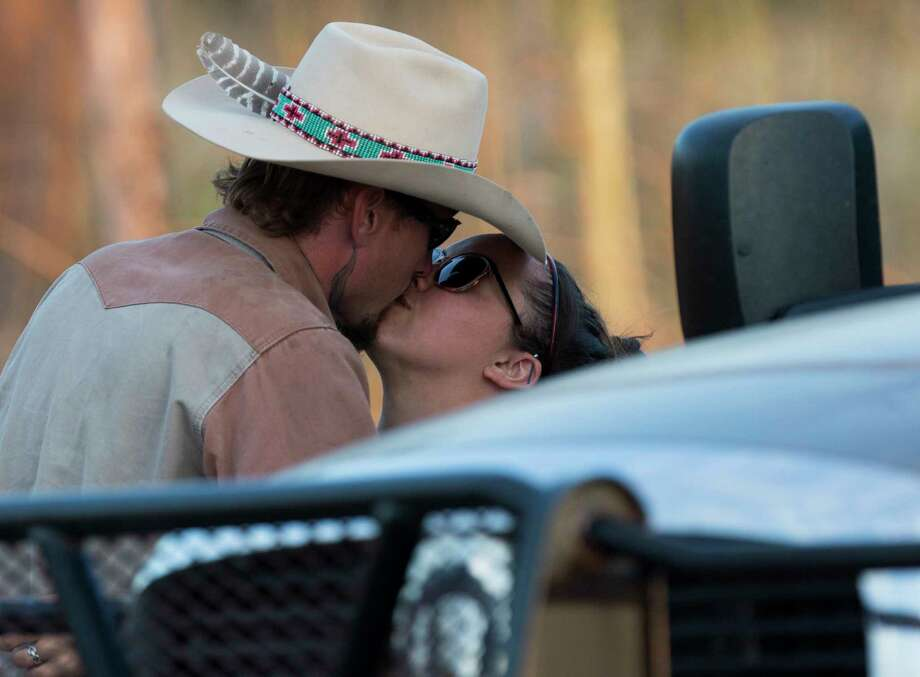 Johnnie Langendorff, who pursued the suspect of the Sutherland Springs First Baptist Church church shooting that killed at least 25 people, gets a kiss Sunday, Nov. 5, 2017 as he is picked up from the scene where the suspect died near the intersection of FM 539 and Sandy Elm Road in Guadalupe County. Officials have not said how the suspect died. Photo: William Luther, San Antonio Express-News / © 2017 San Antonio Express-News