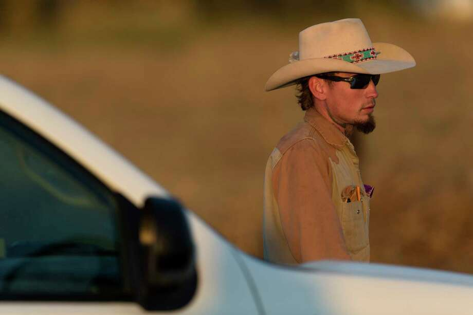Johnnie Langendorff, who pursued the suspect of the Sutherland Springs First Baptist Church shooting that killed at least 25 people, waits Sunday, Nov. 5, 2017 to be picked up from the scene where the suspect died near the intersection of FM 539 and Sandy Elm Road in Guadalupe County. Officials have not said how the suspect died. Langendorff had to be picked up from the scene because his vehicle was being held inside the crime scene. Photo: William Luther, San Antonio Express-News / © 2017 San Antonio Express-News