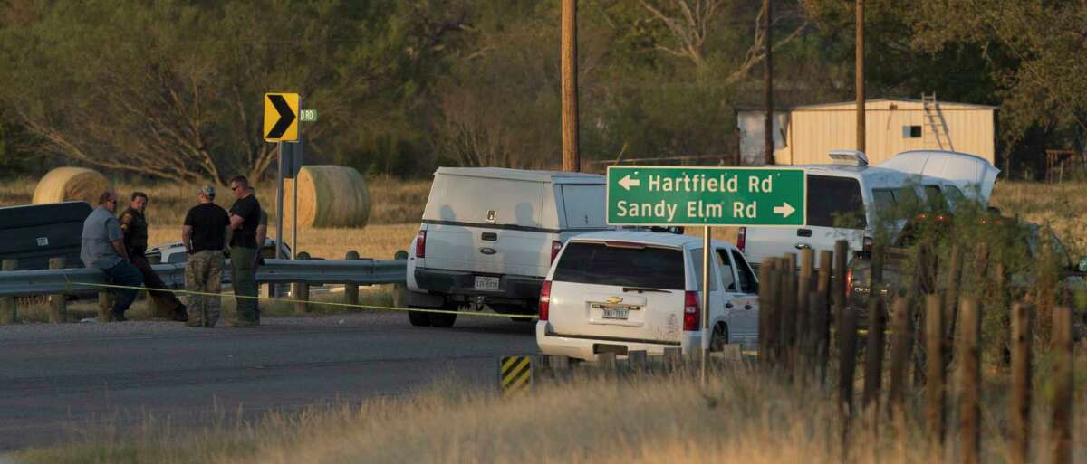 The scene near the intersection of FM 539 and Sandy Elm Road in Guadalupe County is secured Sunday, Nov. 5, 2017 where the alleged shooter in the Sutherland Springs First Baptist Church church shooting that killed at least 25 people fled to in a vehicle. The alleged shooter, identified by the New York Times News Service as Devin P. Kelley, 26, died at the scene but officials haven't said how he died.