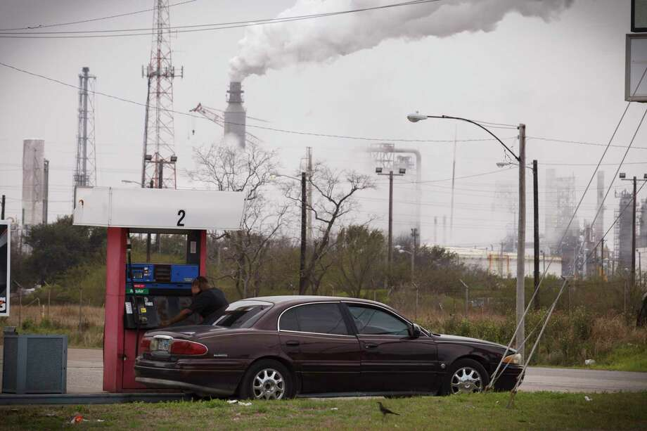 Steam comes from refineries near a gas station in Texas City in  2014.  (Michael Stravato/The New York Times) Photo: MICHAEL STRAVATO, STR / NYTNS