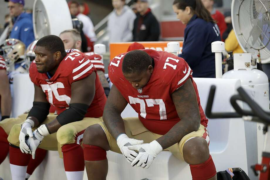 San Francisco 49ers offensive guard Laken Tomlinson (75) and offensive tackle Trent Brown (77) sit on the bench during the second half of an NFL football game against the Arizona Cardinals in Santa Clara on Sunday, Nov. 5, 2017.  Photo: Marcio Jose Sanchez, Associated Press