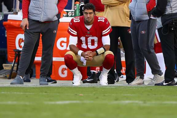 SANTA CLARA, CA - NOVEMBER 05:  Jimmy Garoppolo #10 of the San Francisco 49ers looks on from the sidelines against the Arizona Cardinals during their NFL game at Levi's Stadium on November 5, 2017 in Santa Clara, California.  (Photo by Ezra Shaw/Getty Images)