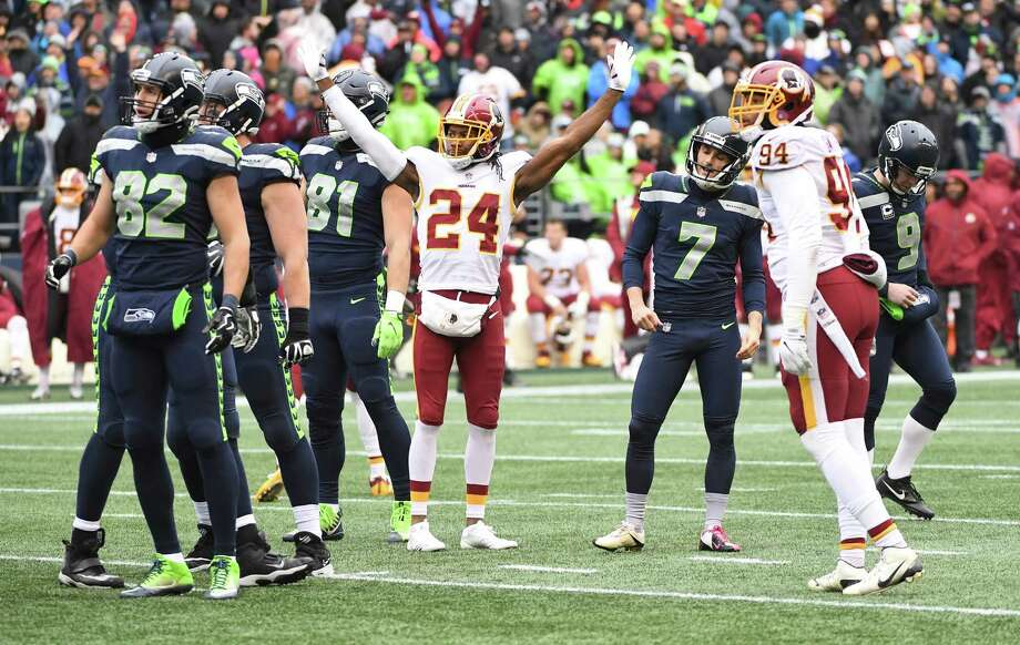 Josh Norman celebrates the third missed field goal of the game by Blair Walsh at the end of the first half. Photo: Washington Post Photo By Jonathan Newton / The Washington Post