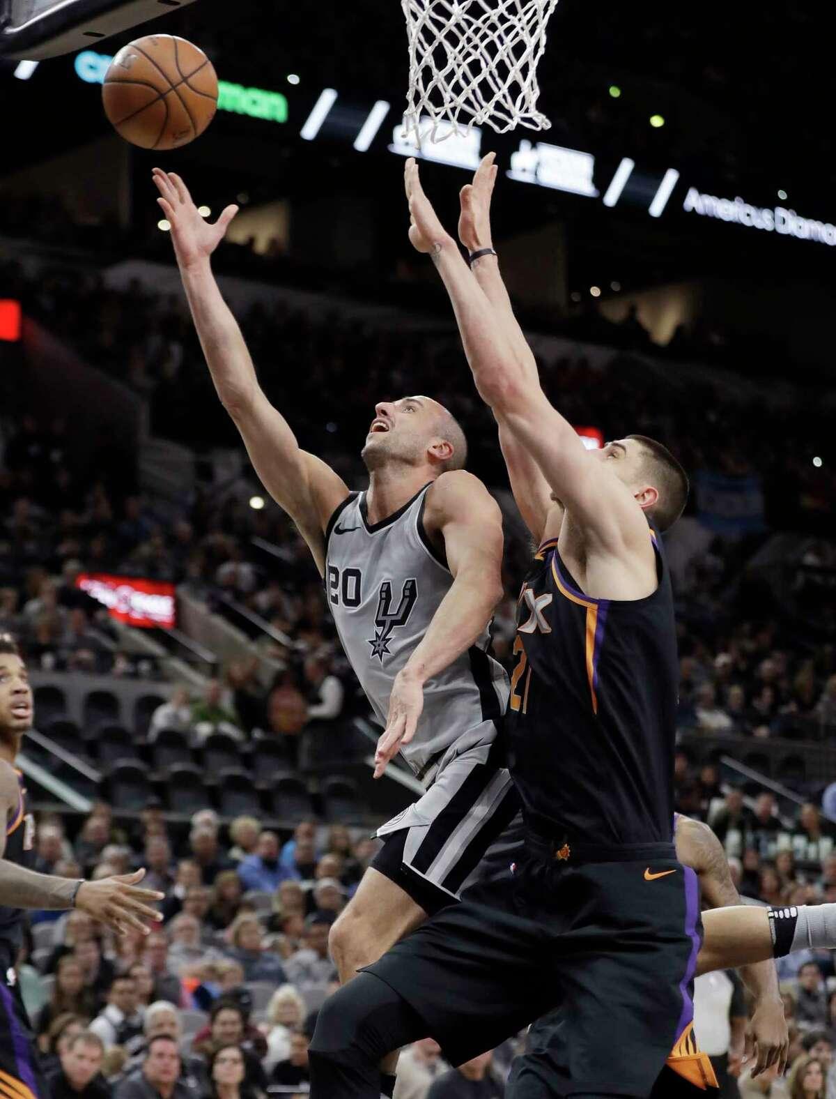 San Antonio Spurs guard Manu Ginobili (20) shoots past Phoenix Suns center Alex Len (21) during the first half of an NBA basketball game Friday, Jan. 5, 2018, in San Antonio. (AP Photo/Eric Gay)