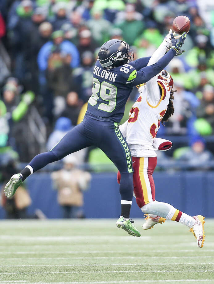 Seahawks wide receiver Doug Baldwin misses a pass while being guarded by Washington safety Montae Nicholson during the second half of an NFL game at CenturyLink Field on Sunday, Nov. 5, 2017. Photo: GRANT HINDSLEY, SEATTLEPI.COM / SEATTLEPI.COM