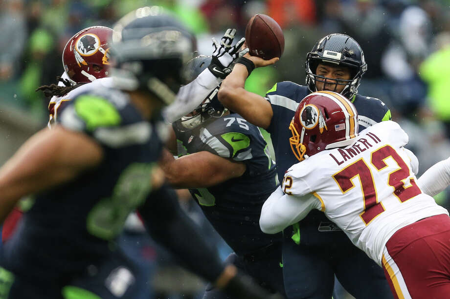 Washington defensive lineman Anthony Lanier II hits Seahawks quarterback Russell Wilson during the first half of an NFL game at CenturyLink Field on Sunday, Nov. 5, 2017. Photo: GRANT HINDSLEY, SEATTLEPI.COM / SEATTLEPI.COM