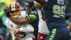 Seahawks linebacker Bobby Wagner sacks Washington quarterback Kirk Cousins for a touchback during the first half of an NFL game at CenturyLink Field on Sunday, Nov. 5, 2017.