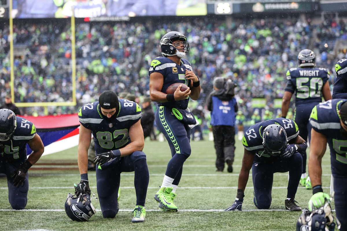 QUARTERBACKGrade: B+ Russell Wilson has completed 62 percent of his passes (20th in the league) for 2,305 yards, 17 touchdowns and six interceptions, with a quarterback rating of 96 (11th in the league). He is also the team's leading rusher, carrying the ball 46 times for 271 yards and a touchdown. While the offense has become practically one-dimensional, Wilson has proceeded to be one excellent dimension, producing behind an inconsistent offensive line and completing play-action passes without the threat of a rushing attack. The knock here is his accuracy. At times, Wilson has been on fire. Then, in games such as the one against Washington, Wilson is off target. But, thrice, Wilson has thrown for over 300 yards, which includes a 452-yard day versus Houston, evidence that he's capable of carrying the offense if need be.