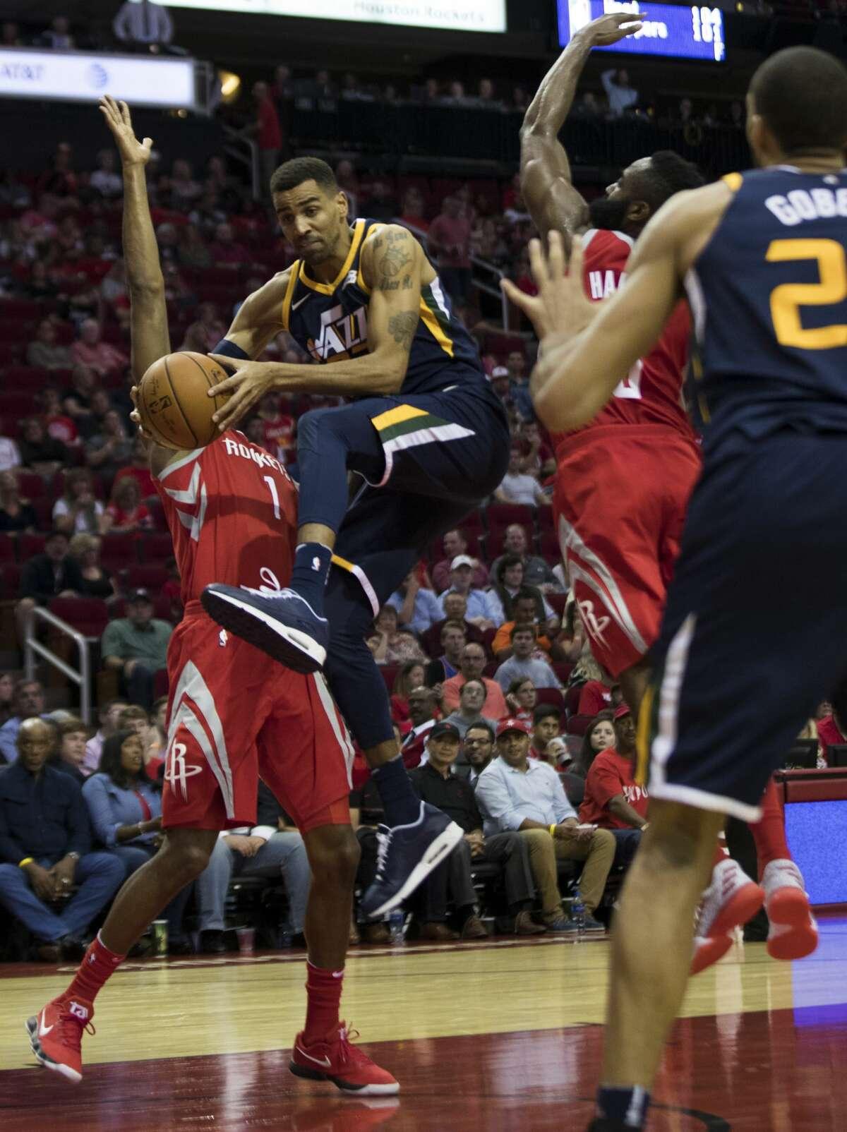 Utah Jazz forward Thabo Sefolosha (22) drives under the pressure of Houston Rockets forward Trevor Ariza (1) and Houston Rockets guard James Harden (13) on Sunday, Nov. 5, 2017, in Houston. ( Marie D. De Jesus / Houston Chronicle )