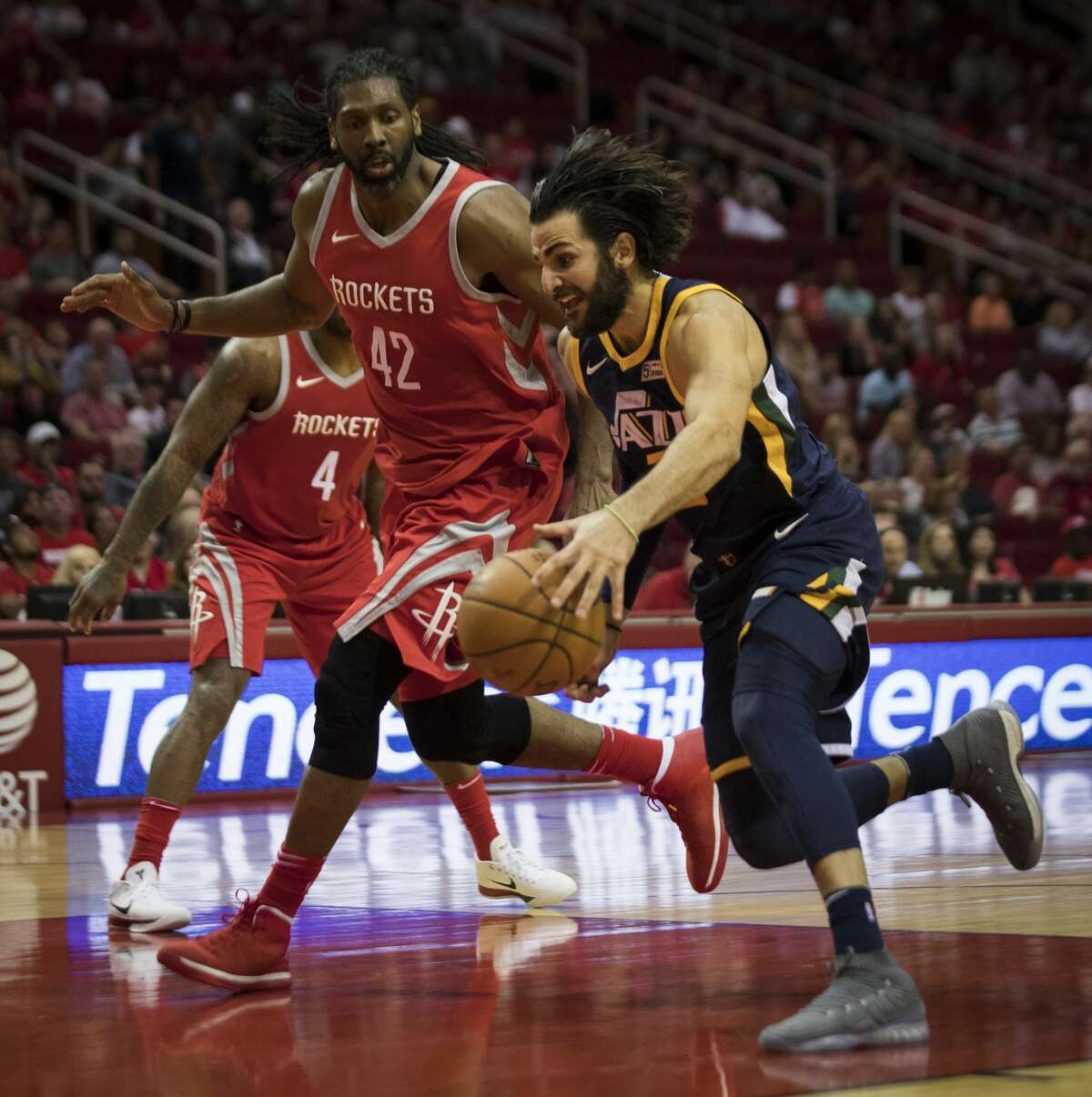 Utah Jazz guard Ricky Rubio (3) is defended by Houston Rockets center Nene Hilario (42) during the first half of the game between the Rockets and the Utah Jazz, Sunday, Nov. 5, 2017, at the Toyota Center in Houston. ( Marie D. De Jesus / Houston Chronicle )