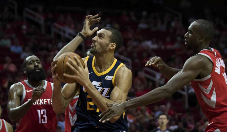 Utah Jazz center Rudy Gobert (27) is defended by Houston Rockets guard James Harden, left, (13) and Houston Rockets forward Luc Mbah a Moute (12) on Sunday, Nov. 5, 2017, at the Toyota Center in Houston. ( Marie D. De Jesus / Houston Chronicle ) Photo: Marie D. De Jesus/Houston Chronicle
