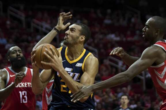 Utah Jazz center Rudy Gobert (27) is defended by Houston Rockets guard James Harden, left, (13) and Houston Rockets forward Luc Mbah a Moute (12) on Sunday, Nov. 5, 2017, at the Toyota Center in Houston. ( Marie D. De Jesus / Houston Chronicle )