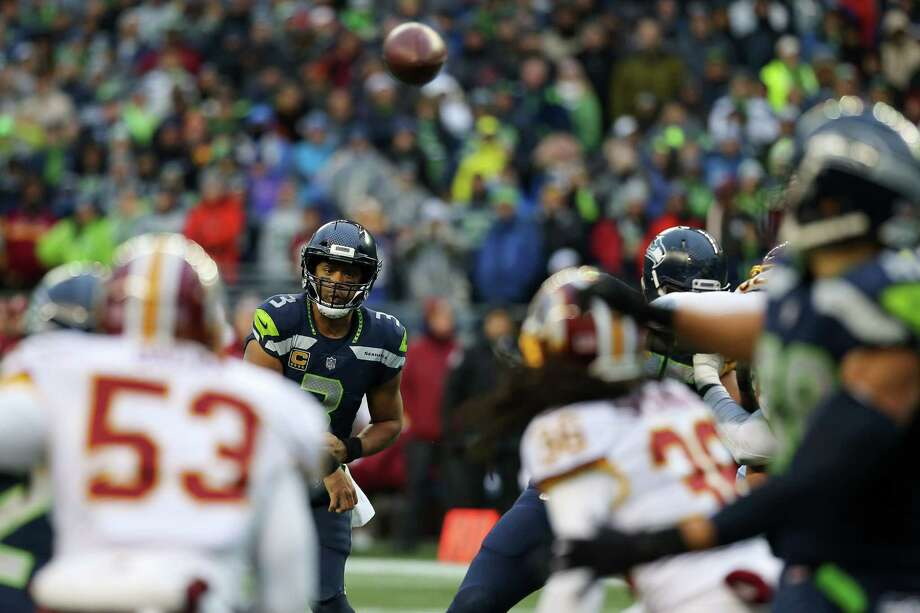 Two-point problemsSeattle tried two, two-point conversions Sunday; neither was successful. On the try following Luke Willson's 10-yard touchdown catch early in the fourth quarter, Russell Wilson was intercepted by DJ Swearinger, who jumped the QB's pass toward J.D. McKissic. Washington had the play scouted well. After carrying Jimmy Graham up the field, Swearinger let the tight end roam free and leaped directly in front of the slanting McKissic. (While Graham rolled free, his defender, linebacker Zach Brown didn't bother to cover him and immediately keyed on McKissic.) Swearinger's decision to abandon his assignment fooled Wilson, resulting in an interception.After Doug Baldwin's go-ahead score later in the game, Seattle again lined up to attempt a conversion. But before the ball was snapped, Seattle had to burn a timeout -- it's second of the half -- before throwing incomplete to Graham in the back of the end zone; he was wide open, Wilson threw high and Graham couldn't make the leaping grab. Lining up late cost Seattle a timeout that could have made a significant difference on Seattle's final offensive drive of the game. Photo: GENNA MARTIN, SEATTLEPI / SEATTLEPI.COM