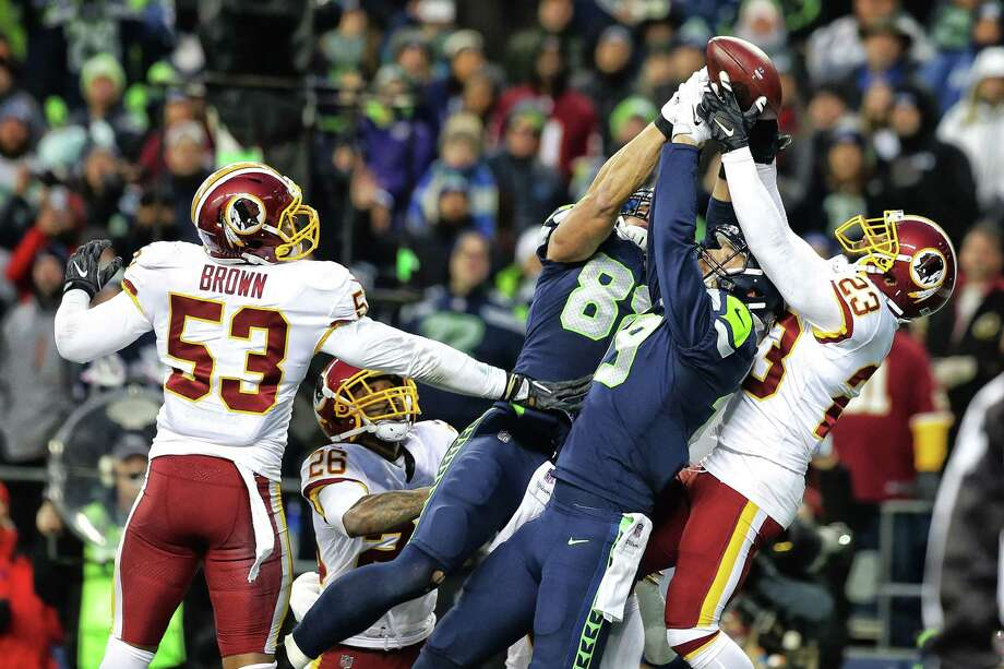 Seahawks tight end Jimmy Graham (88) and Tanner MacAvoy (19) attempt to snag a Hail Mary pass as the final seconds of Seattle's game against Washington count down, Sunday, Nov. 5, 2017 at CenturyLink Field. Photo: GENNA MARTIN, SEATTLEPI / SEATTLEPI.COM
