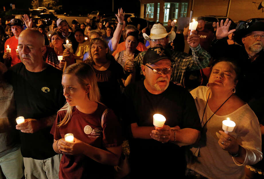 People attend a candle light vigil for the shooting at the First Baptist Church of Sutherland Springs Sunday Nov 5, 2017. Photo: Edward A. Ornelas, San Antonio Express-News / © 2017 San Antonio Express-News