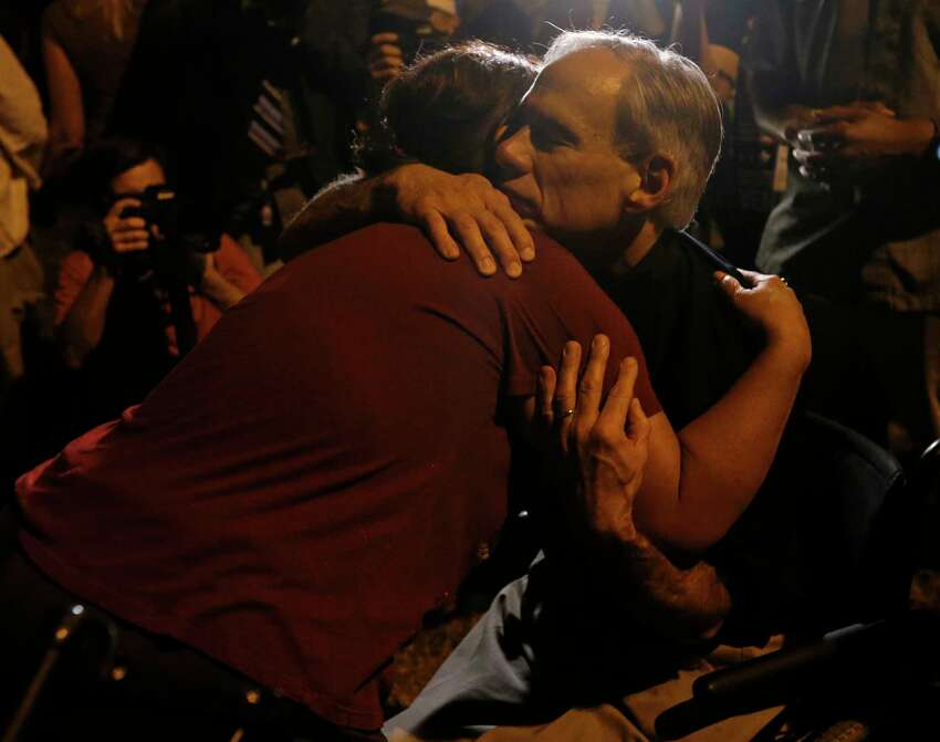 Texas Gov. Greg Abbott hugs Sutherland Springs resident Aleida Mora during a candle light vigil for the shooting at the First Baptist Church of Sutherland Springs Sunday Nov 5, 2017.