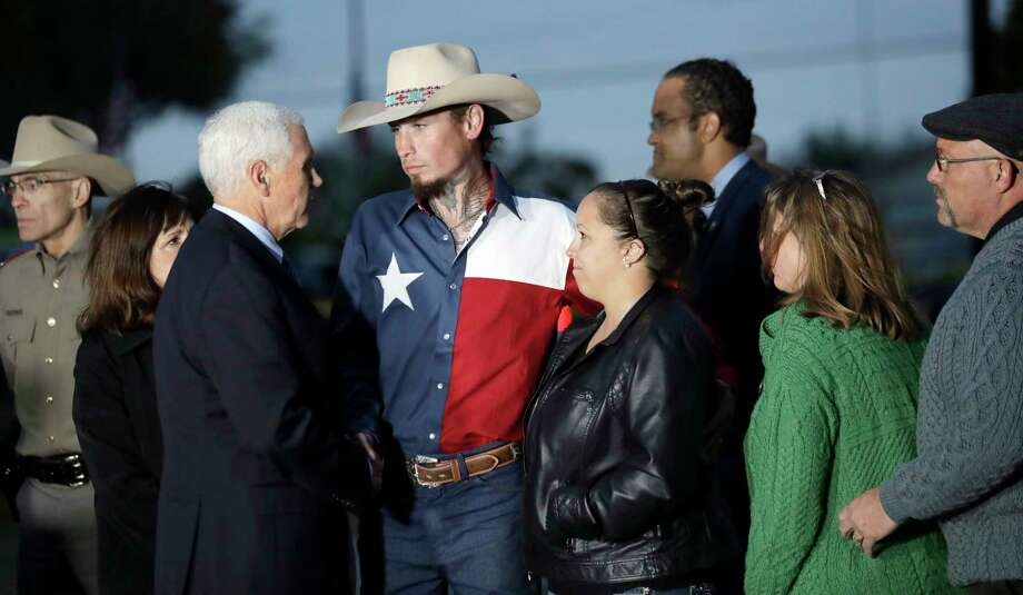Vice President Mike Pence and his wife, Karen, talks with Johnnie Langendorff, and his girlfriend Summer Caddell, third from right, as they visit with first responders, family, friends and victims outside the Sutherland Spring Baptist Church Wednesday, Nov. 8, 2017, in Sutherland Springs, Texas. A man opened fire inside the church in the small South Texas community on Sunday, killing and wounding many. Pastor Frank Pomeroy and his wife Sherri are at right. (AP Photo/Eric Gay) Photo: Eric Gay, Associated Press / Copyright 2017 The Associated Press. All rights reserved.