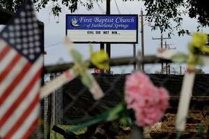 Rain collects flowers, notes and items left at a makeshift memorial for the victims of the shooting at Sutherland Springs Baptist Church, Sunday, Nov. 12, 2017, in Sutherland Springs, Texas. A man opened fire inside the church in the small South Texas community a week ago, killing more than two dozen. (AP Photo/Eric Gay)
