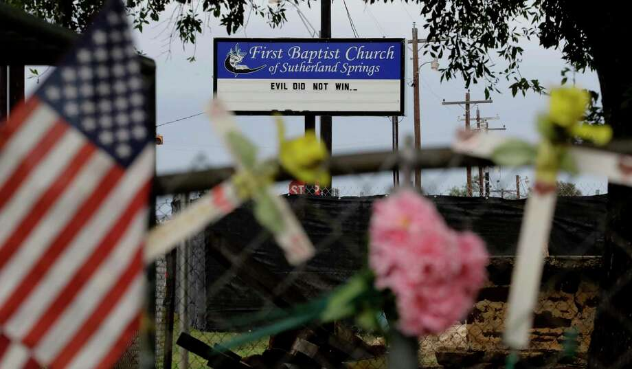 Rain collects flowers, notes and items left at a makeshift memorial for the victims of the shooting at Sutherland Springs Baptist Church, Sunday, Nov. 12, 2017, in Sutherland Springs, Texas. A man opened fire inside the church in the small South Texas community a week ago, killing more than two dozen. (AP Photo/Eric Gay) Photo: Eric Gay, Associated Press / Copyright 2017 The Associated Press. All rights reserved.