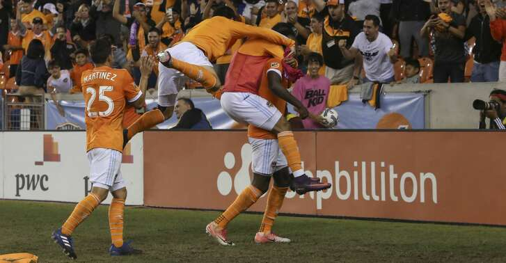Houston Dynamo players celebrting Houston Dynamo forward Alberth Elis's (17) goal during the first half of OT of the first-round playoff MLS match against the Sporting Kansas City at BBVA Compass Stadium Thursday, Oct. 26, 2017, in Houston. ( Yi-Chin Lee / Houston Chronicle )
