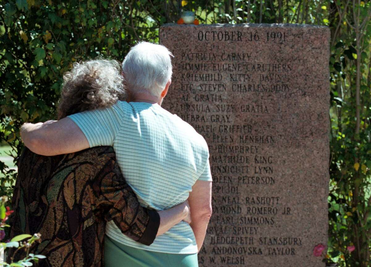 Elizabeth Chancellor (left) and Evelyn Seales comfort each other during a 2001 memorial for the Luby's massacre in Killeen. Sunday's tragedy at a Sutherland Springs church has surpassed the 1991 shooting at a Killeen Luby's as the deadliest in Texas history.