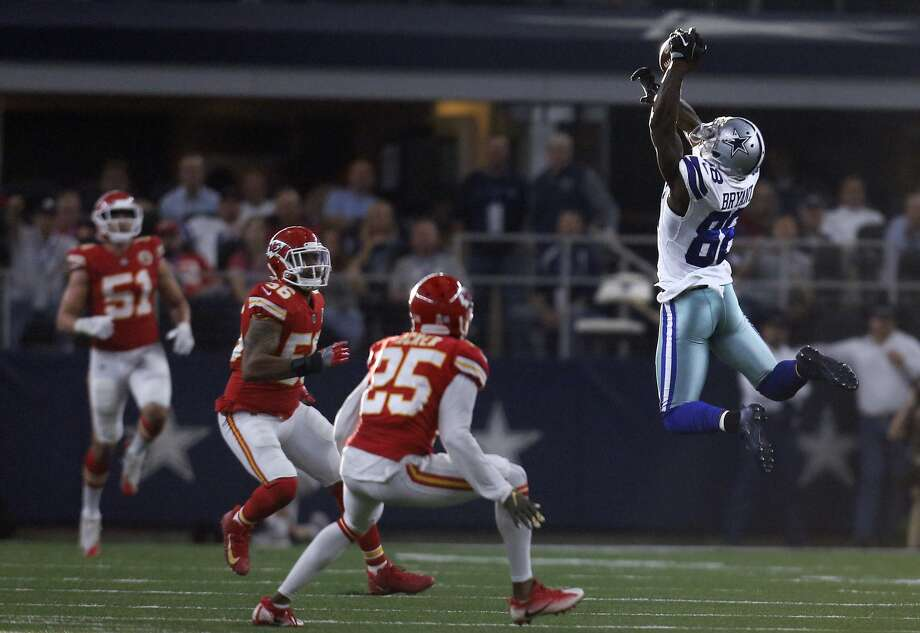 Dallas Cowboys wide receiver Dez Bryant (88) reaches up to catch a pass as Kansas City Chiefs' Derrick Johnson (56) and Kenneth Acker (25) defend in the first half of an NFL football game, Sunday, Nov. 5, 2017, in Arlington, Texas. (AP Photo/Brandon Wade)