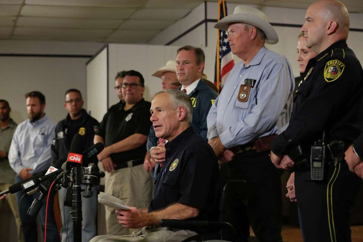 Gov. Greg Abbott addresses the media at the Stockdale City Hall during a news conference concerning the mass shooting Sunday at the First Baptist Church in Sutherland Springs.