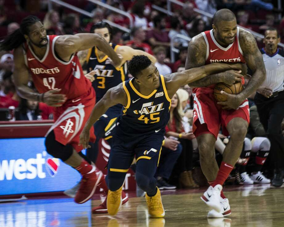 Utah Jazz guard Donovan Mitchell (45) battles for the ball against Houston Rockets forward PJ Tucker, right, (4) and Houston Rockets center Nene Hilario (42) during the second half of the game on Sunday, Nov. 5, 2017, at the Toyota Center in Houston. The Rockets won against the Utah Jazz 137-110. ( Marie D. De Jesus / Houston Chronicle ) Photo: Marie D. De Jesus/Houston Chronicle