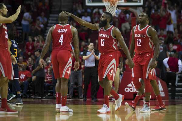 Houston Rockets guard James Harden (13) shares a moment with Houston Rockets forward PJ Tucker (4) after Harden scored against the Utah Jazz on Sunday, Nov. 5, 2017, in Houston. ( Marie D. De Jesus / Houston Chronicle )