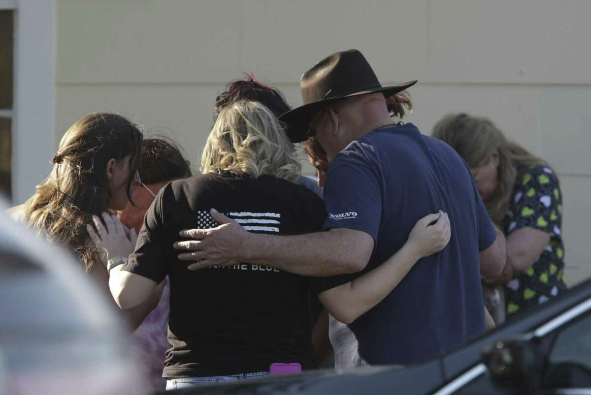 A group is gathered in prayer outside the Community Center, on Sunday, Nov. 5 2017, in Sutherland Springs, Tx. where a mass shooting occurred at the First Baptist Church.