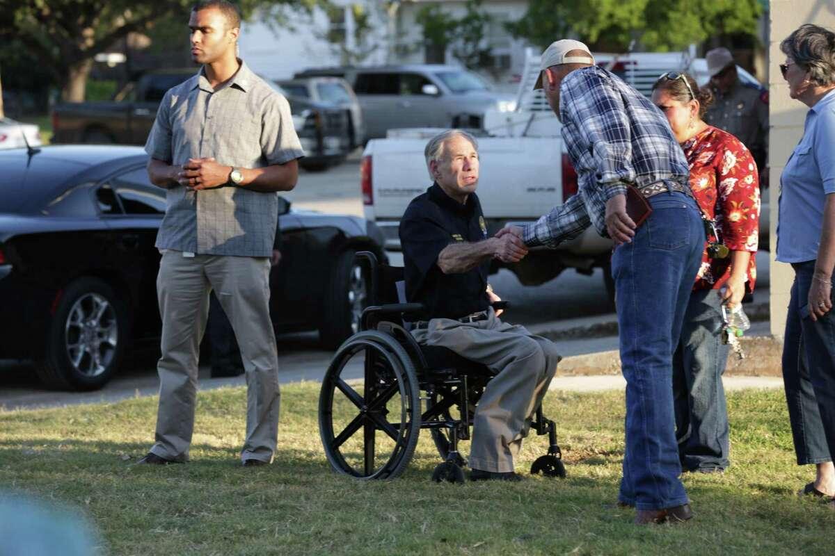 Texas Gov Greg Abbott arrives at the Stockdale City Hall for a press conference on Sunday, Nov. 5 2017.