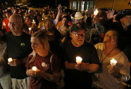 People attend a candle light vigil for the shooting at the First Baptist Church of Sutherland Springs Sunday Nov 5, 2017.