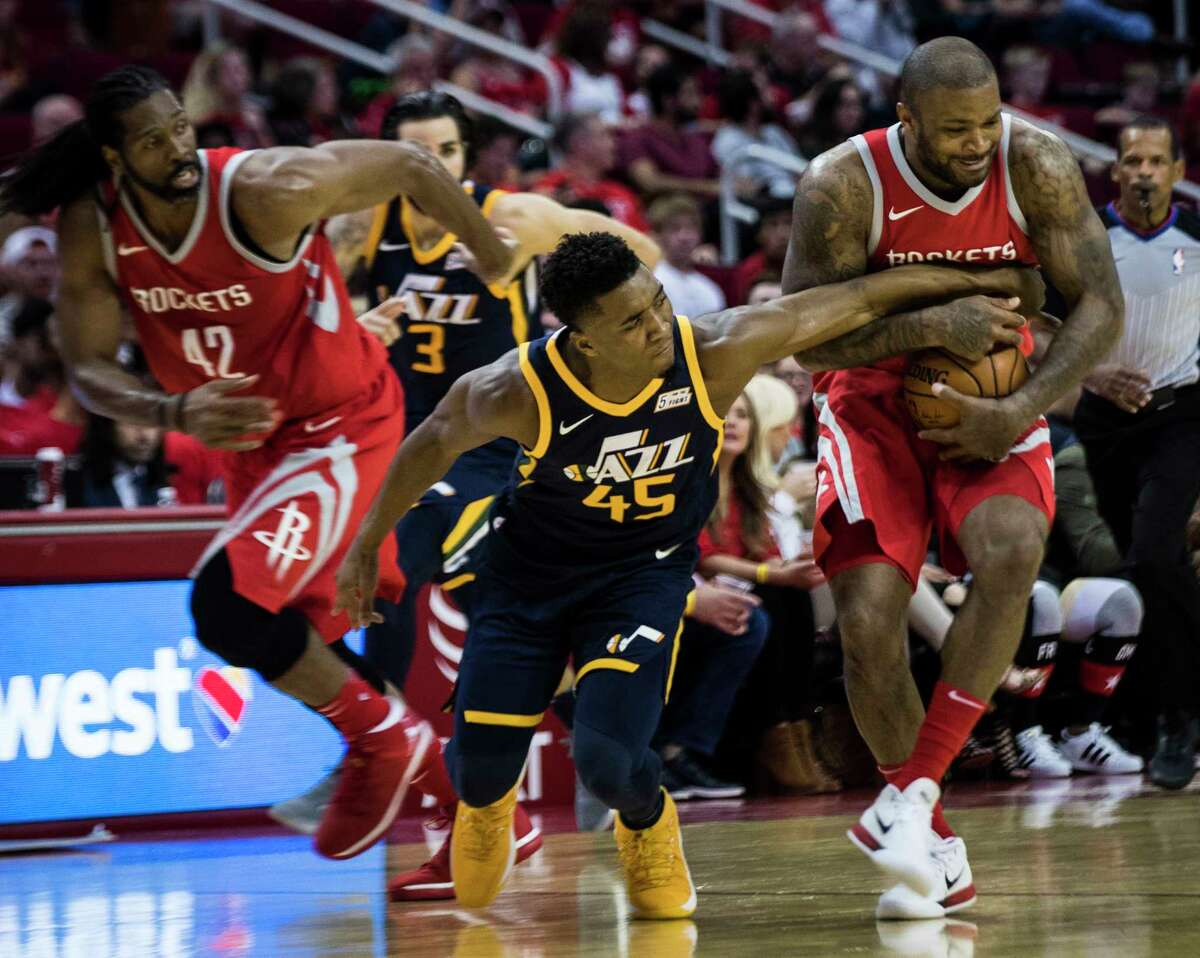 Jazz rookie guard Donovan Mitchell (45) battles for the ball against Rockets forward P.J. Tucker, right, in the second half of Sunday's game at Toyota Center. Tucker played 29 minutes off the bench in the 137-110 win.