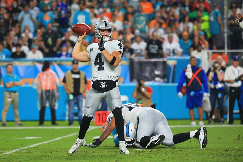 Quarterback Derek Carr #4 of the Oakland Raiders looks to pass the ball during a game against the Miami Dolphins  at Hard Rock Stadium on November 5, 2017 in Miami Gardens, Florida.  (Photo by Chris Trotman/Getty Images) Photo: Chris Trotman, Getty Images