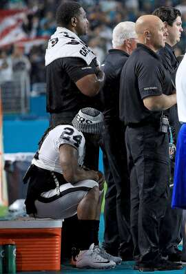 MIAMI GARDENS, FL - NOVEMBER 05:  Marshawn Lynch #24 of the Oakland Raiders sits during the national anthem during a game against the Miami Dolphins at Hard Rock Stadium on November 5, 2017 in Miami Gardens, Florida.  (Photo by Mike Ehrmann/Getty Images)