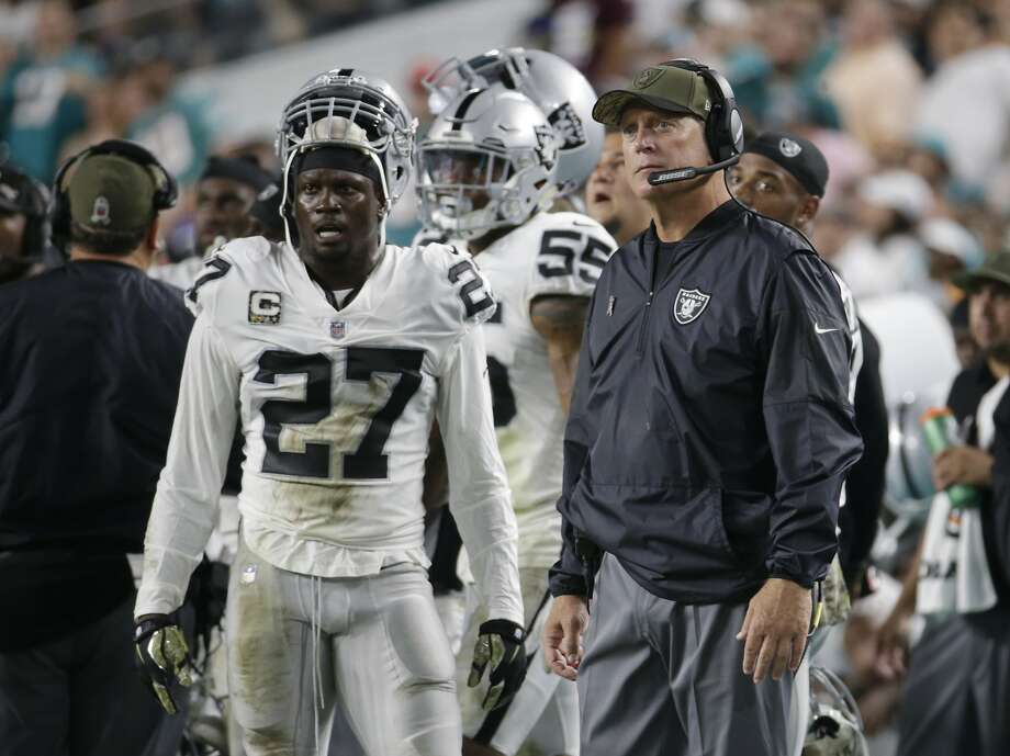 Raiders coach Jack Del Rio and safety Reggie Nelson react after giving up a touchdown Sunday night in Miami. Oakland won despite allowing the Dolphins' offense to gain 395 yards. Photo: Lynne Sladky, Associated Press