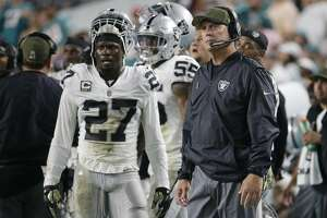 Oakland Raiders head coach Jack Del Rio and free safety Reggie Nelson (27) reacts after the Miami Dolphins scores a touchdown, during the first half of an NFL football game, Sunday, Nov. 5, 2017, in Miami Gardens, Fla. (AP Photo/Lynne Sladky)