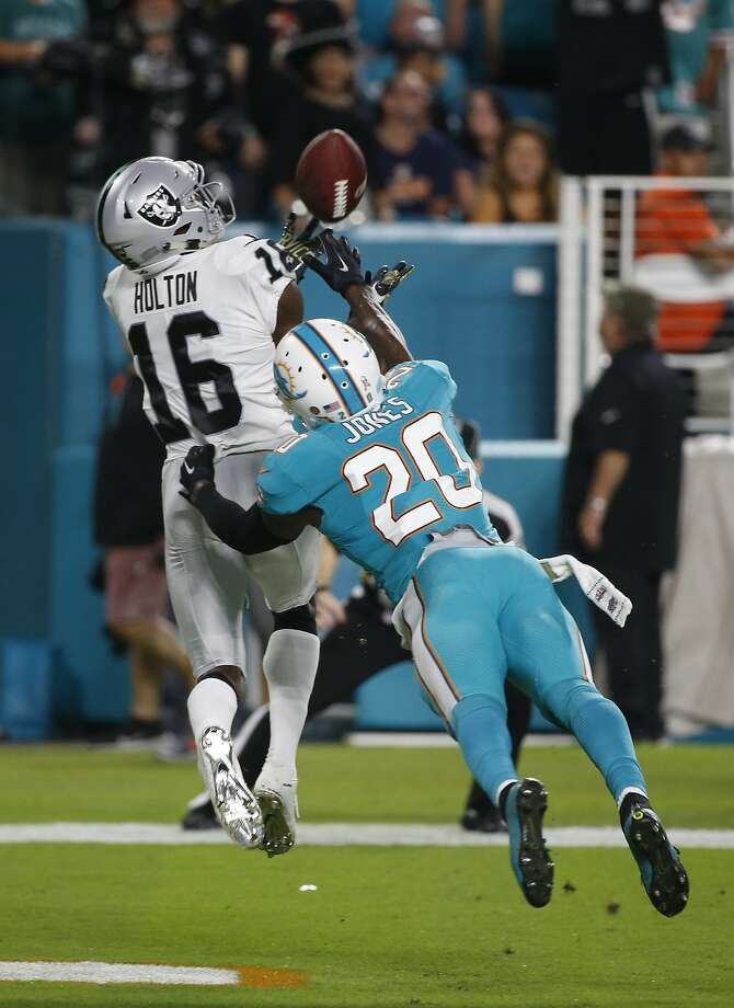 Oakland Raiders wide receiver Johnny Holton (16) grabs a touchdown pass as Miami Dolphins free safety Reshad Jones (20) attempts to defend, during the first half of an NFL football game, Sunday, Nov. 5, 2017, in Miami Gardens, Fla. (AP Photo/Wilfredo Lee) Photo: Wilfredo Lee, Associated Press