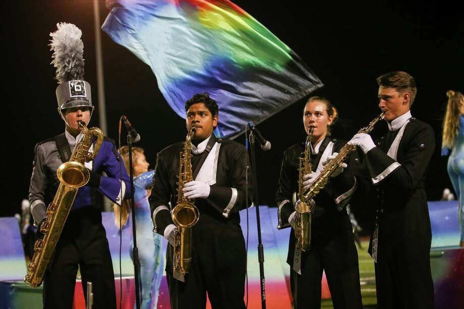 Soloists, including Willis drum majors Andrew Fennell, far right, Rebecca Lowery, center right, and Andrew Vinalay, center left, perform during the UIL State Marching Championship send off on Sunday, Nov. 5, 2017, at Berton A. Yates Stadium in Willis. Photo: Michael Minasi, Staff Photographer / © 2017 Houston Chronicle