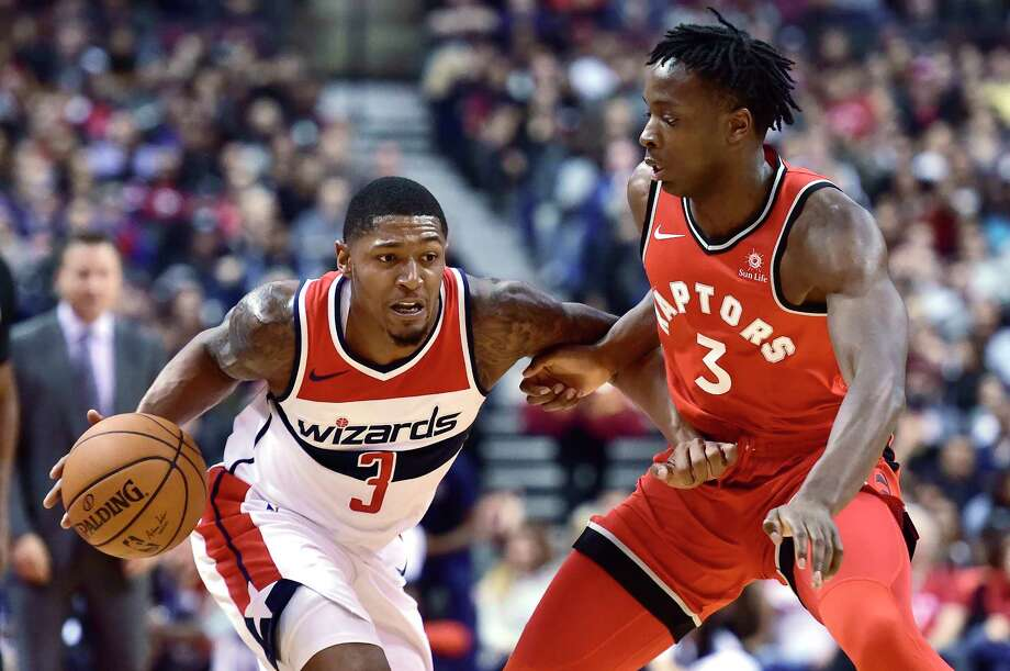 The Wizards' Bradley Beal (3), who scored 38 points, dribbles the ball under pressure from the Raptors'  OG Anunoby in the Wizards' 107-96 win. Photo: Frank Gunn, SUB / The Canadian Press