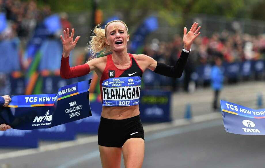 Shalane Flanagan of the United States is overcome with emotion as she crosses the finish line to win the New York City Marathon on Sunday, becoming the first American to win the race since 1977. Photo: TIMOTHY A. CLARY, Contributor / AFP or licensors