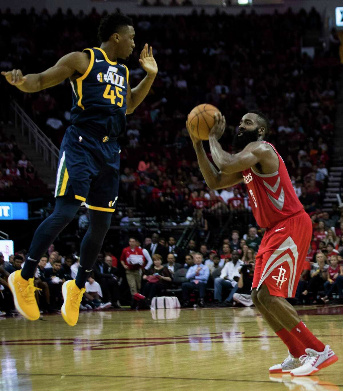 Rockets guard James Harden, right, shoots the ball under pressure from Utah guard Donovan Mitchell. Harden finished with a career-high 56 points - one point shy of Calvin Murphy's franchise record.