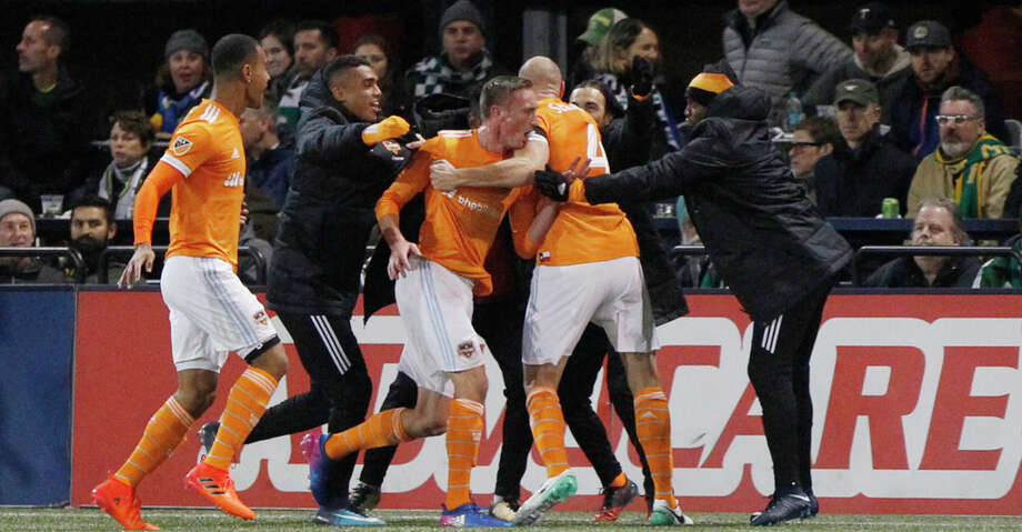 Houston Dynamo players celebrate a goal during the second leg of their 2017 MLS Cup soccer playoffs matchup against the Portland Timbers in Portland, Ore. on Sunday, Nov. 5, 2017. (Sean Meagher/The Oregonian via AP) Photo: Sean Meagher/Associated Press