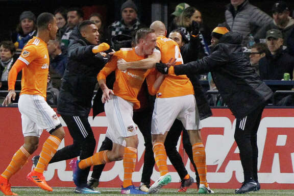 Houston Dynamo players celebrate a goal during the second leg of their 2017 MLS Cup soccer playoffs matchup against the Portland Timbers in Portland, Ore. on Sunday, Nov. 5, 2017. (Sean Meagher/The Oregonian via AP)