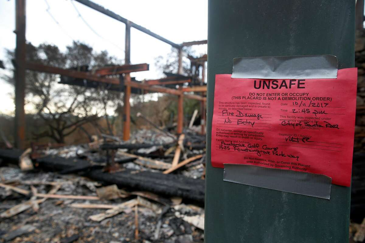 The clubhouse is red tagged at the Fountaingrove Golf Club in Santa Rosa, Calif. on Thursday, Nov. 2, 2017. Fountaingrove hopes to reopen the course in mid-November despite its clubhouse and other buildings getting burned to the ground in last month's Tubbs Fire.