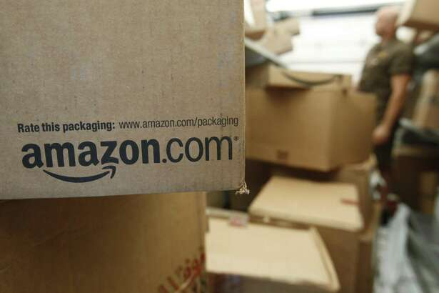 According to the Connecticut Better Business Bureau, end-of-year package delivery fraud has evolved in recent years, with consumers losing money and personal information as a result of the schemes. One of the sites commonly abused by scammers is Amazon. (AP Photo/Paul Sakuma, File)