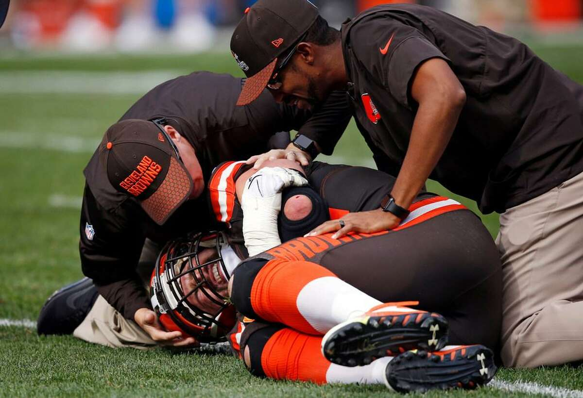 Trainers check Cleveland Browns tackle Joe Thomas after he was injured in a game against Tennessee on Oct. 22, 2017 in Cleveland.