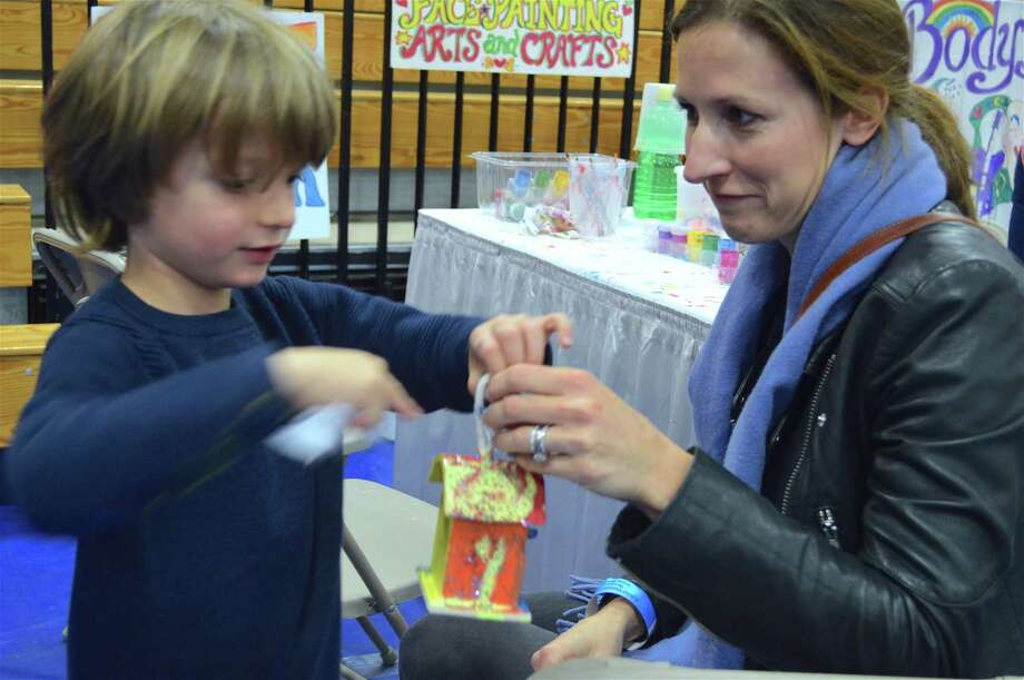 An enthusiastic Cameron Leitch, 5, of Westport, shares his creation with his mom, Alison, at the 42nd annual CraftWestport fair at Staples High School, Sunday, Nov. 5, 2017, in Westport, Conn. Photo: Jarret Liotta / For Hearst Connecticut Media / Westport News Freelance