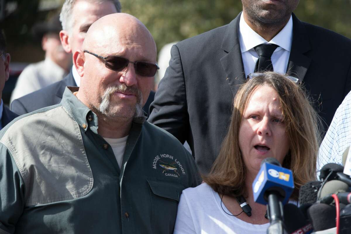 Pastor Frank Pomeroy and his wife Sherri speak at a press conference on November 6, 2017 at the First Baptist Church in Sutherland Springs, Texas following a mass shooting that left 26 people dead including their 14 year old daughter. A gunman wearing all black armed with an assault rifle opened fire on a small-town Texas church during Sunday morning services, killing 26 people and wounding 20 more in the last mass shooting to shock the United States.